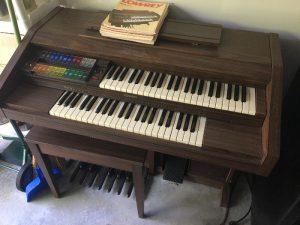 Double Piano on purple carpet